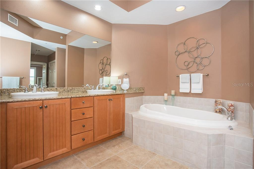 Master Bath Suite has soaking tub for your relaxation - Condo for sale at 8561 Amberjack Cir #202, Englewood, FL 34224 - MLS Number is D6109771