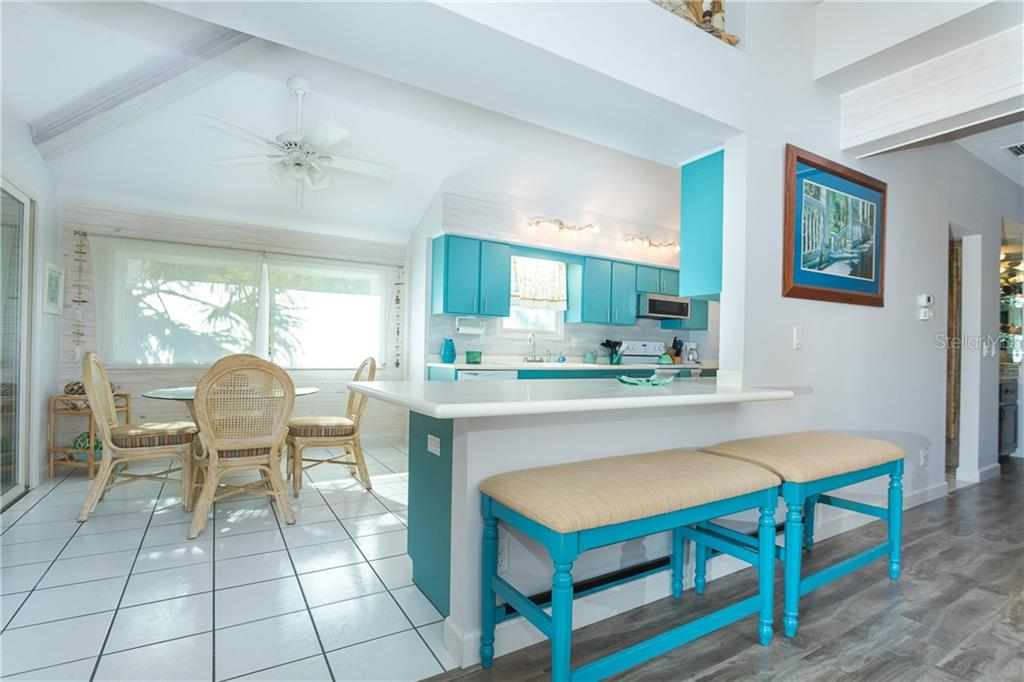 Eat In Kitchen and Breakfast Bar. - Single Family Home for sale at 540 N Gulf Blvd, Placida, FL 33946 - MLS Number is D6110801
