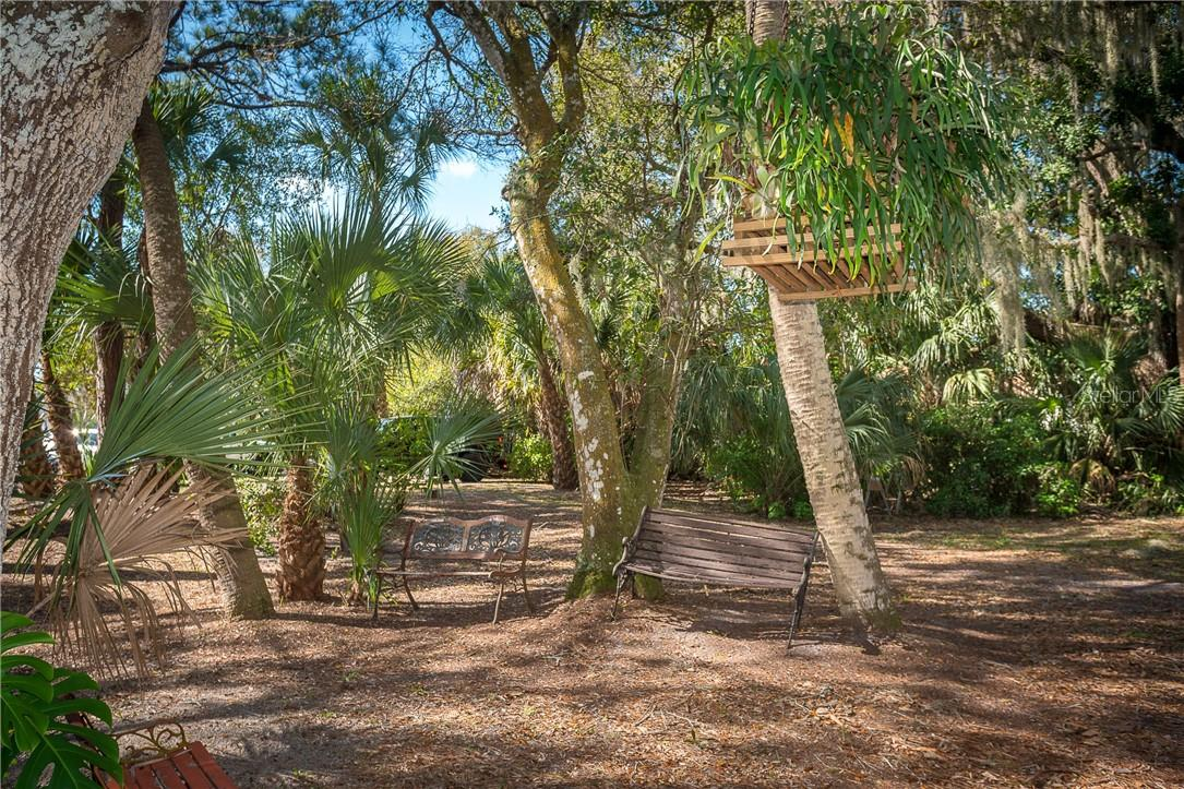 A variety of seating areas all along this 1 1/4 acre property - Single Family Home for sale at 1199 Seahorse Ln, Englewood, FL 34224 - MLS Number is D6110877