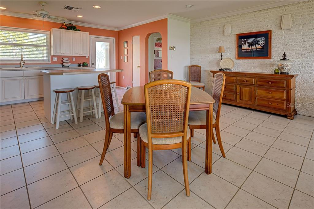 Complete open concept from sun up to sun down. There is a fireplace behind the sideboard under the painting. Light and bright. - Single Family Home for sale at 918 Edgewater Dr, Englewood, FL 34223 - MLS Number is D6111167