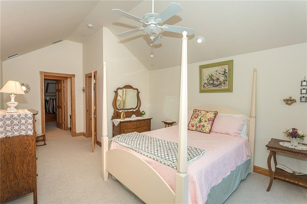 Bedroom 2 offers a huge walk-in closet and private vanity with sink. - Single Family Home for sale at 550 S Oxford Dr, Englewood, FL 34223 - MLS Number is D6111512