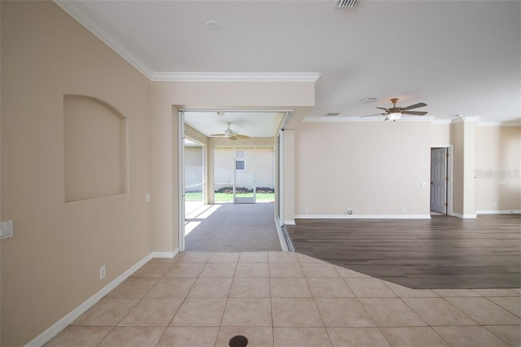 FAMILY ROOM SHOWING 90 DEGREE SLIDER - Single Family Home for sale at 3583 Royal Palm Dr, North Port, FL 34288 - MLS Number is D6111716