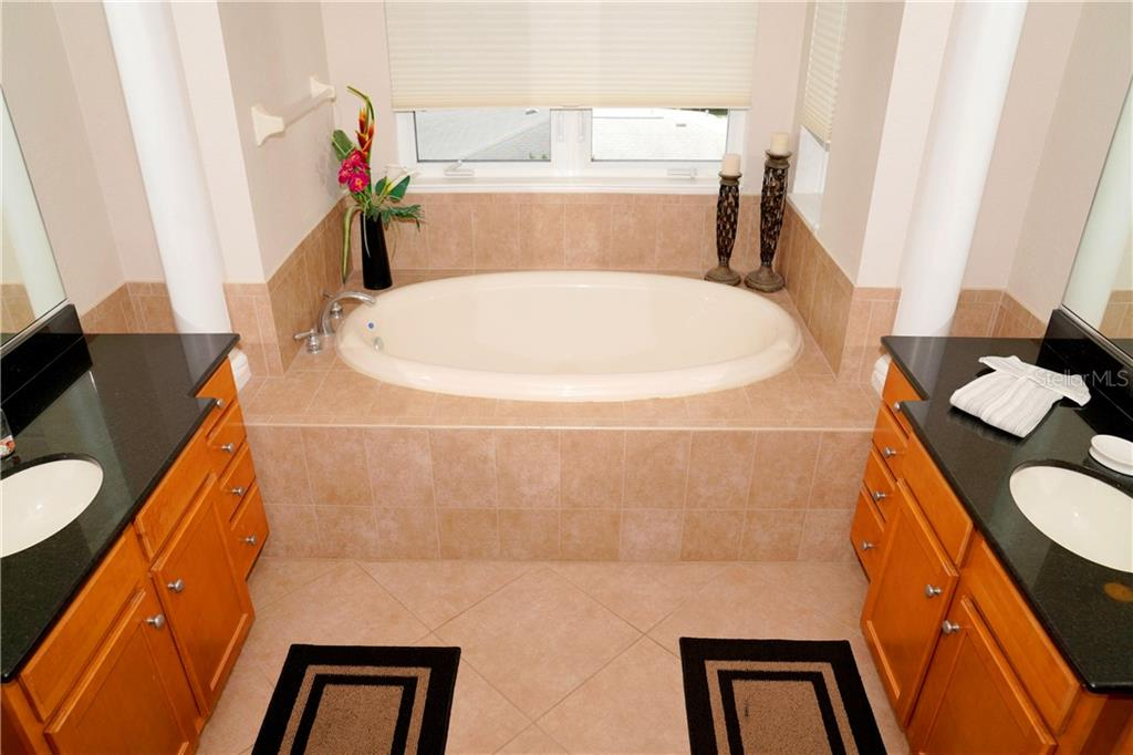 View of soaker tub and vanities with sinks on each side. - Condo for sale at 2245 N Beach Rd #304, Englewood, FL 34223 - MLS Number is D6112346