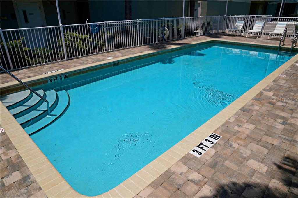 Another pool view - Condo for sale at 2245 N Beach Rd #304, Englewood, FL 34223 - MLS Number is D6112346