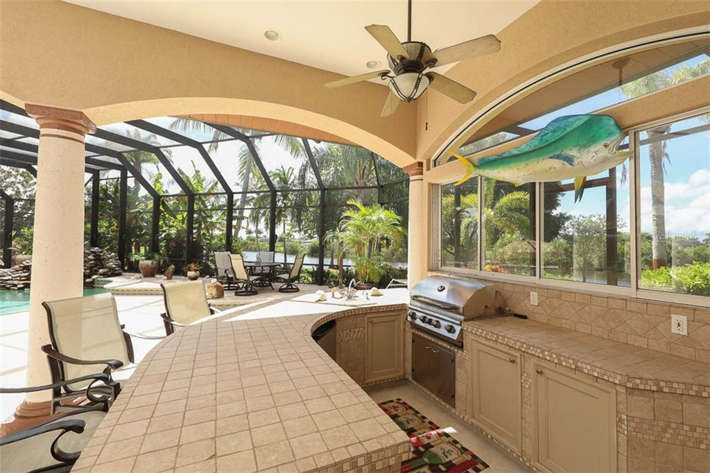 Outdoor Kitchen Grilling Area - Single Family Home for sale at 9300 Hialeah Ter, Port Charlotte, FL 33981 - MLS Number is D6113597