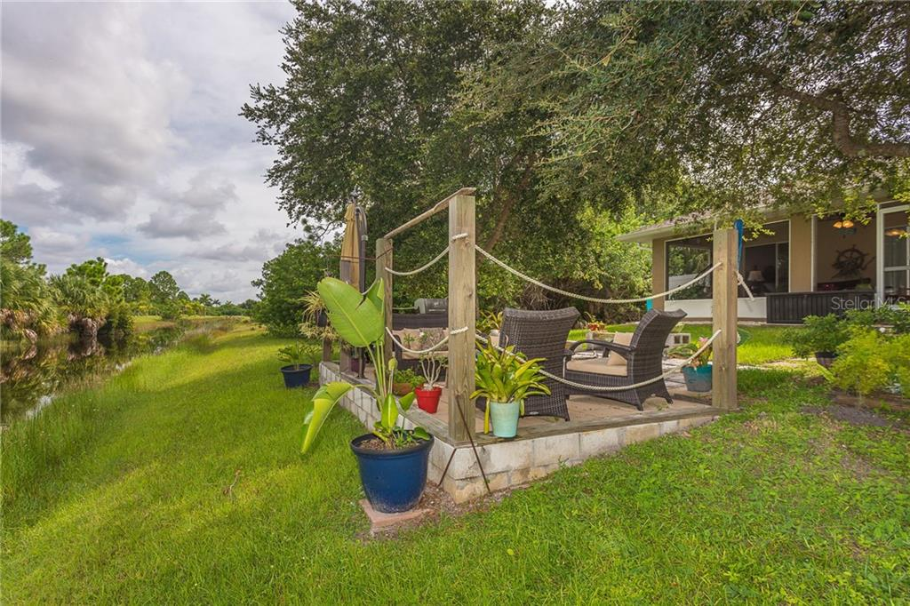 Patio offers room for entertaining or just relaxing in the shade - Single Family Home for sale at 185 Apollo Dr, Rotonda West, FL 33947 - MLS Number is D6113690