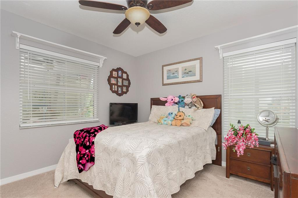 Bedroom two with Bahama style shutters on the exterior and blinds inside for privacy. - Single Family Home for sale at 185 Apollo Dr, Rotonda West, FL 33947 - MLS Number is D6113690