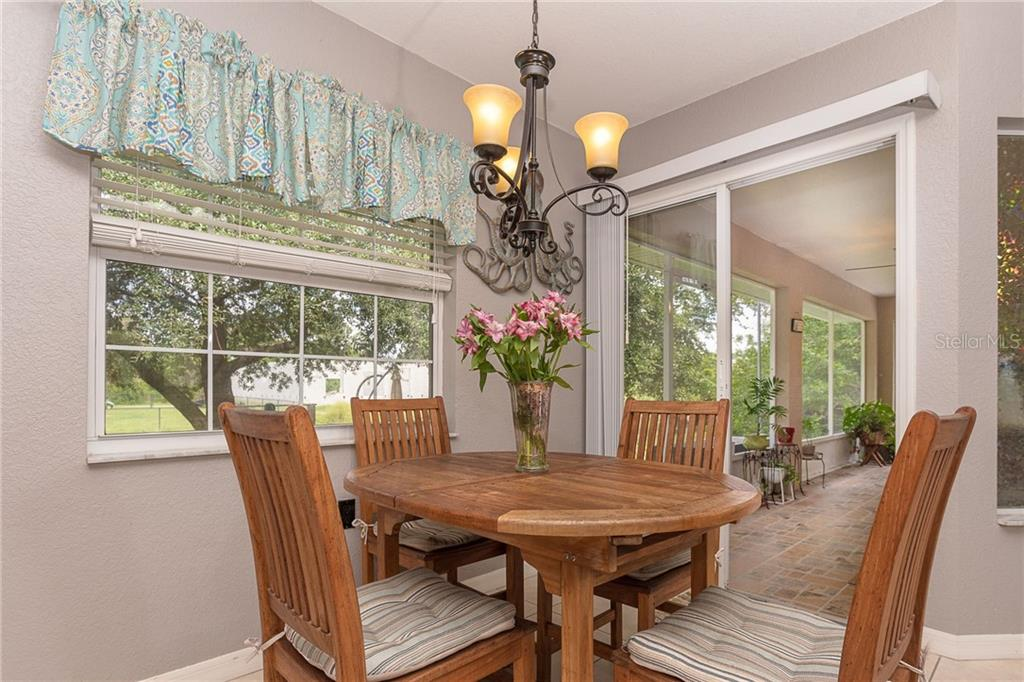 Custom Teak dining table - Single Family Home for sale at 185 Apollo Dr, Rotonda West, FL 33947 - MLS Number is D6113690