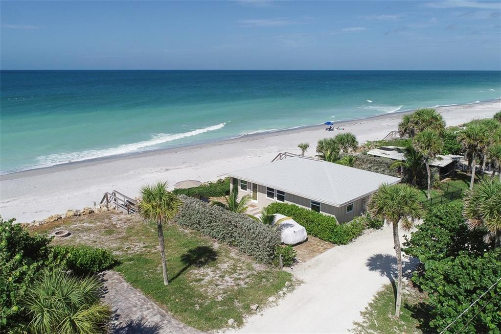 Walkways to beach/gulf on either side of the cottage - Single Family Home for sale at 4074 N Beach Rd #Ctg4, Englewood, FL 34223 - MLS Number is D6114111