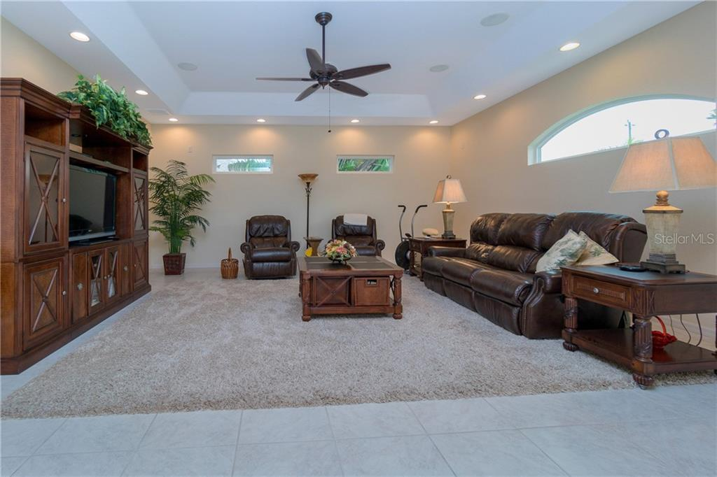 Another view of the family room. - Single Family Home for sale at 439 Boundary Blvd, Rotonda West, FL 33947 - MLS Number is D6114162