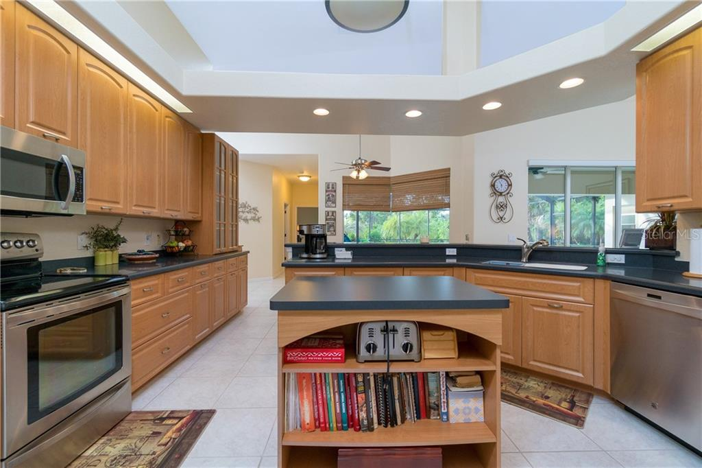 Kitchen has plenty of cabinetry and counter space. - Single Family Home for sale at 439 Boundary Blvd, Rotonda West, FL 33947 - MLS Number is D6114162