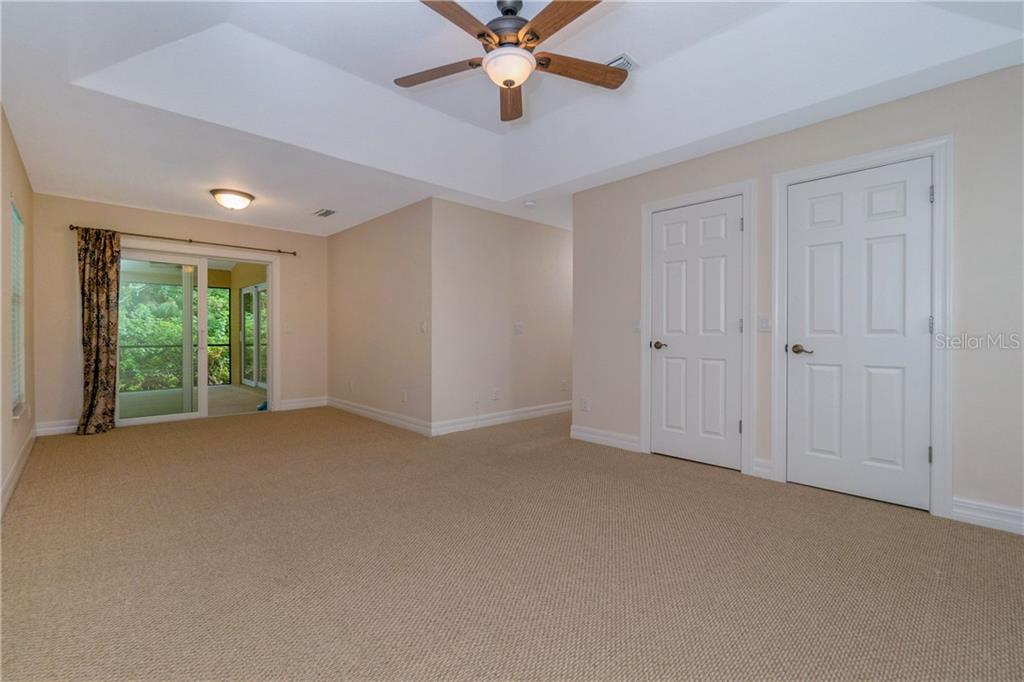 TWO WALK IN CLOSETS AND ACCESS TO THE LANAI AND SWIMMING POOL FROM THE MASTER BEDROOM. - Single Family Home for sale at 112 Boxwood Ln, Rotonda West, FL 33947 - MLS Number is D6114179