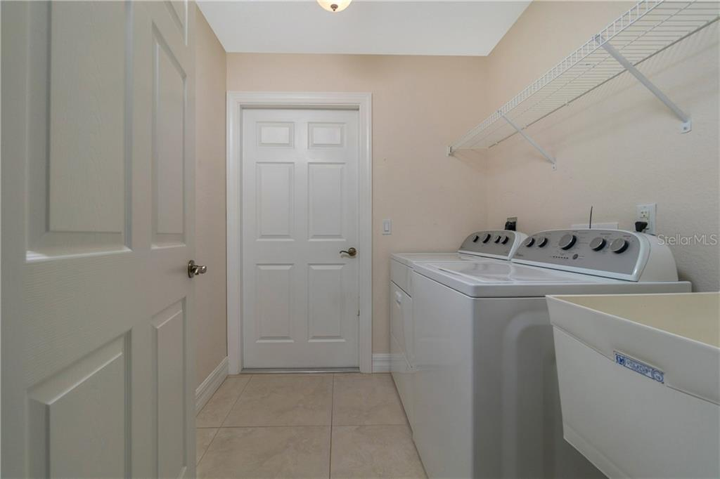 THE LAUNDRY CENTER IS IN A SEPARATE ROOM JUST BEFORE YOU GO OUT TO THE GARAGE. THERE IS ALSO A SOAK SINK IN THE LAUNDRY ROOM. - Single Family Home for sale at 112 Boxwood Ln, Rotonda West, FL 33947 - MLS Number is D6114179