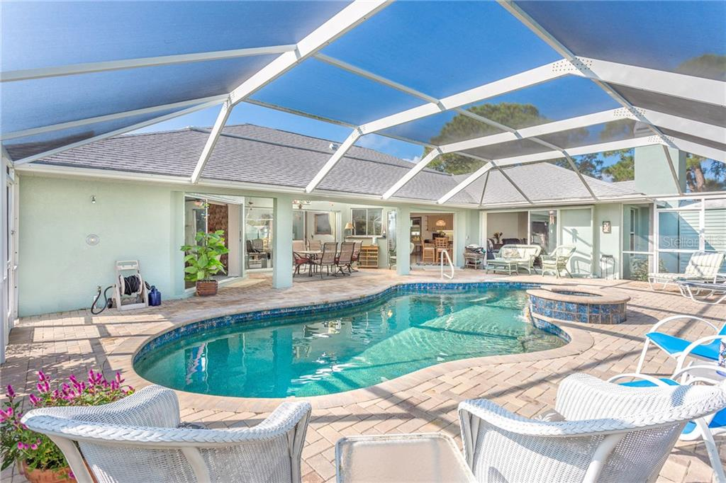 Large screened pool area - Single Family Home for sale at 1720 Larson St, Englewood, FL 34223 - MLS Number is D6114414