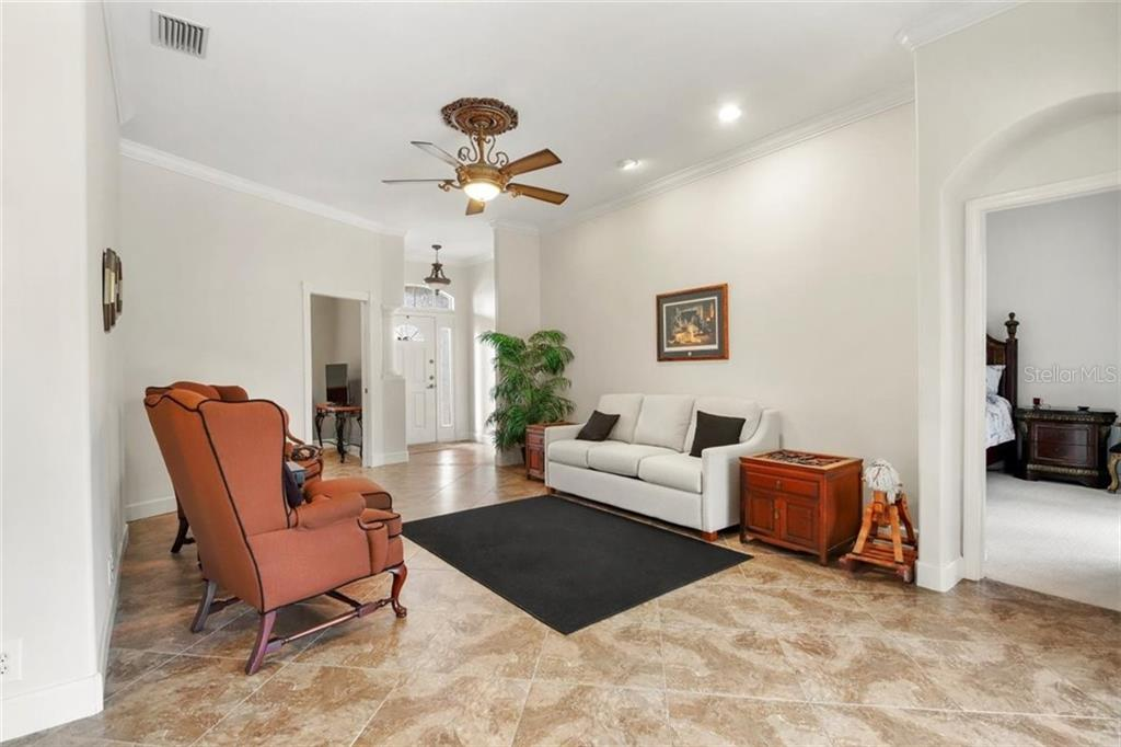 LIVING ROOM - Single Family Home for sale at 1944 Coconut Palm Cir, North Port, FL 34288 - MLS Number is D6114523