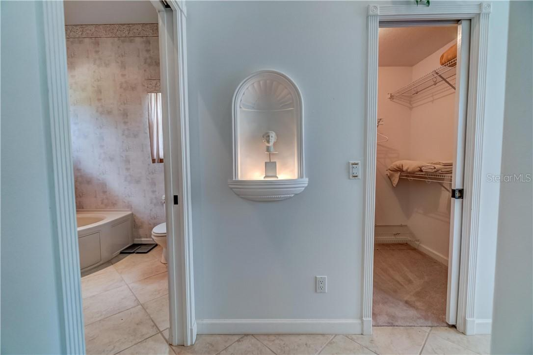 Ahh yes, once again our senses are entertained by the lighted wall nook that greats you as you enter the Master. - Single Family Home for sale at 12307 S Access Rd, Port Charlotte, FL 33981 - MLS Number is D6117140