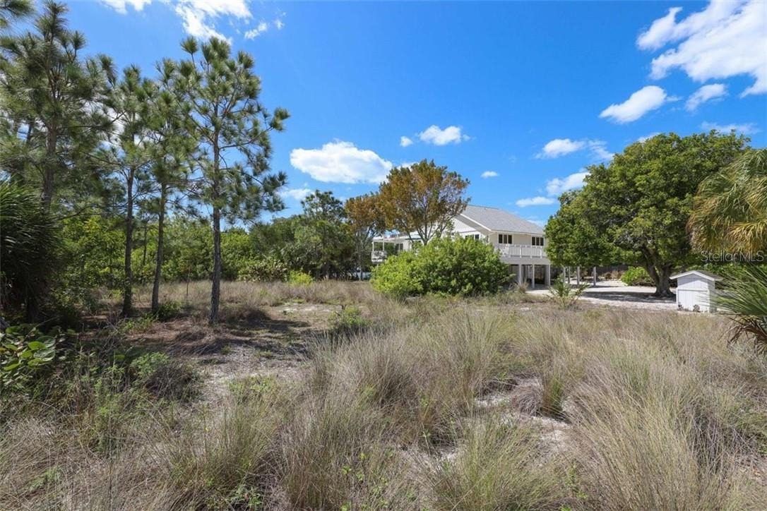 Single Family Home for sale at 331 Bocilla Dr, Placida, FL 33946 - MLS Number is D6117288