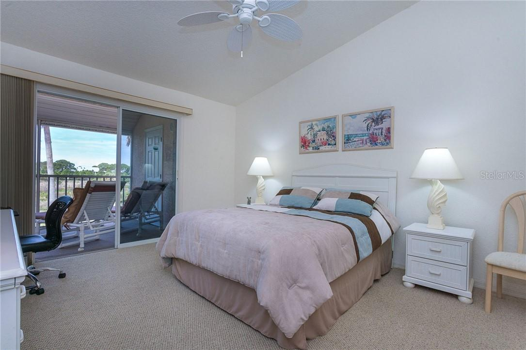 Bedroom 1 has views of the preserve, a walk-in closet and ensuite - Condo for sale at 6610 Gasparilla Pines Blvd #229, Englewood, FL 34224 - MLS Number is D6117434