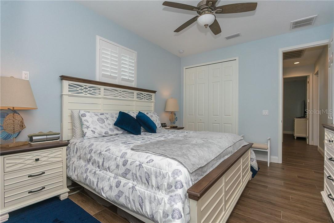 Bedroom 3 is set up as a 2nd master suite with private access to the lanai and private bath - Single Family Home for sale at 145 Leland St Se, Port Charlotte, FL 33952 - MLS Number is D6117438