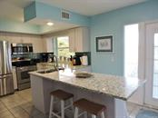 Kitchen and Dining Table. - Single Family Home for sale at 120 Bocilla Dr, Placida, FL 33946 - MLS Number is D5907510