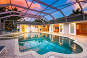 Pool and spa looking at house - Single Family Home for sale at 260 Capstan Dr, Cape Haze, FL 33946 - MLS Number is D5919159