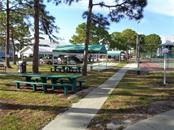 Shuffleboard and community bbq/picnic areas - Condo for sale at 6800 Placida Rd #253, Englewood, FL 34224 - MLS Number is D5919792