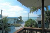 Beautiful gulf view from front porch. - Single Family Home for sale at 8384 Little Gasparilla Is, Placida, FL 33946 - MLS Number is D5922085