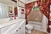 Guest bathroom, tiled. - Single Family Home for sale at 8 Medalist Cir, Rotonda West, FL 33947 - MLS Number is D6104474