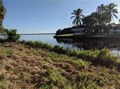 Enjoy amazing water views from your backyard. - Vacant Land for sale at 2400 Vance Ter, Port Charlotte, FL 33981 - MLS Number is D6109360