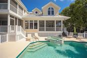 AMAZING WATERFRONT LIVING! - Single Family Home for sale at 500 Anchor Row, Placida, FL 33946 - MLS Number is D6111649
