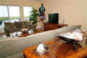Another view of living room and water - Condo for sale at 2245 N Beach Rd #304, Englewood, FL 34223 - MLS Number is D6112346