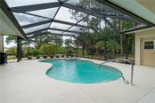 View of the pool and back yard. - Single Family Home for sale at 439 Boundary Blvd, Rotonda West, FL 33947 - MLS Number is D6114162