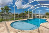 Easy entry pool - Single Family Home for sale at 145 Leland St Se, Port Charlotte, FL 33952 - MLS Number is D6117438