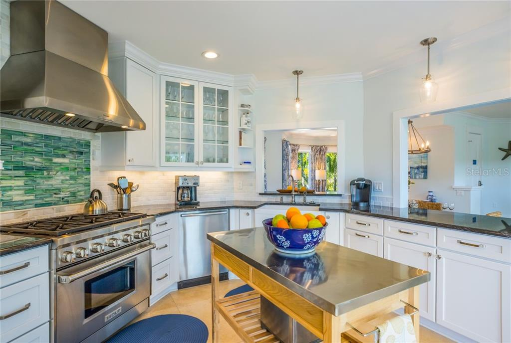 A Wolf six-burner gas range is a highlight of the gourmet kitchen - Single Family Home for sale at 511 Loquat Dr, Anna Maria, FL 34216 - MLS Number is T3196169