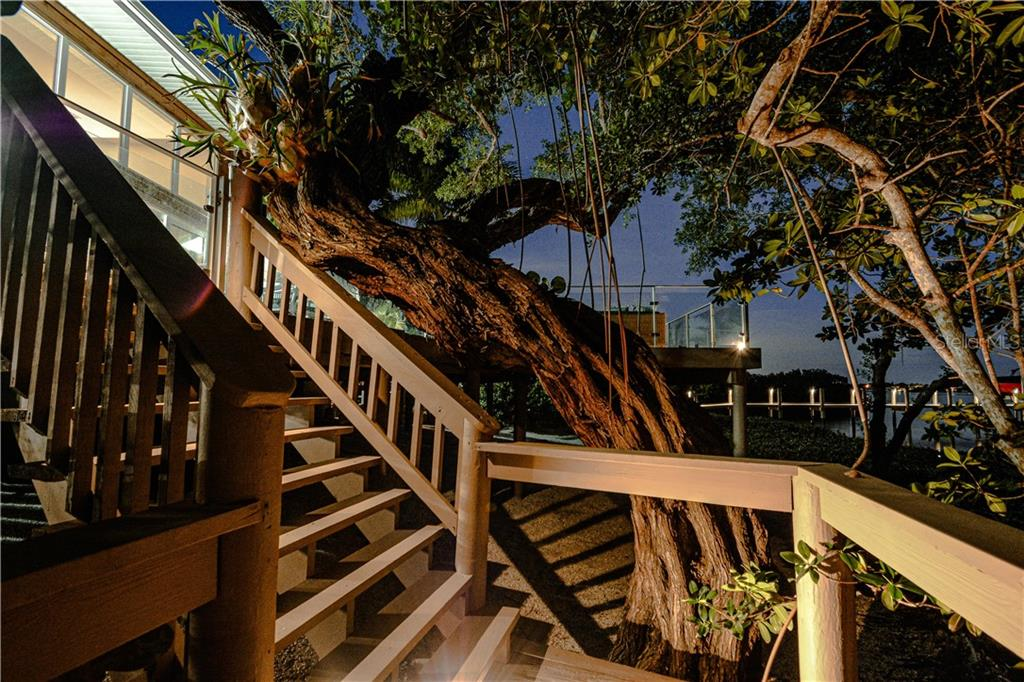 Stairs from lower level deck to deeded dock - Single Family Home for sale at 140 N Casey Key Rd, Osprey, FL 34229 - MLS Number is T3228618
