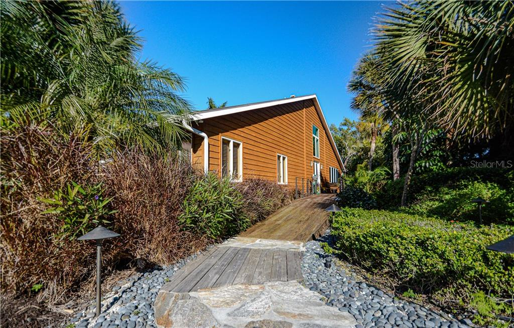 Entrance to the home - Single Family Home for sale at 140 N Casey Key Rd, Osprey, FL 34229 - MLS Number is T3228618