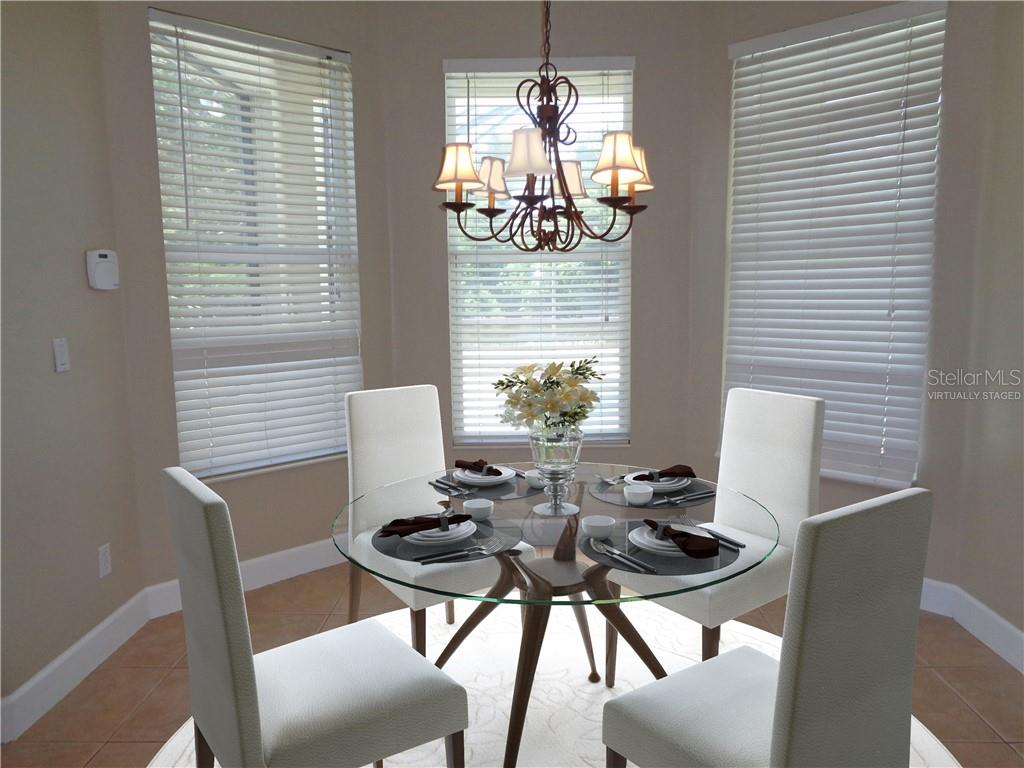 Virtually staged breakfast nook - Single Family Home for sale at 851 Placid Lake Dr, Osprey, FL 34229 - MLS Number is O5712676