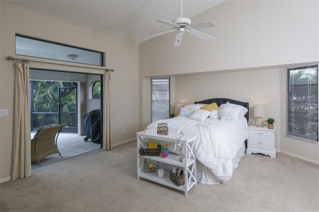 Master bedroom with pocket slider to the lanai - Single Family Home for sale at 3419 Sandpiper Dr, Punta Gorda, FL 33950 - MLS Number is C7232529