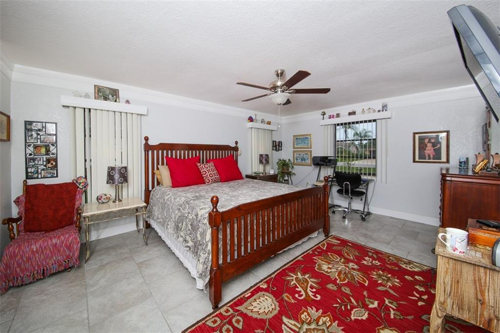 Master bedroom with crown molding - Single Family Home for sale at 26178 Rampart Blvd, Punta Gorda, FL 33983 - MLS Number is C7240559