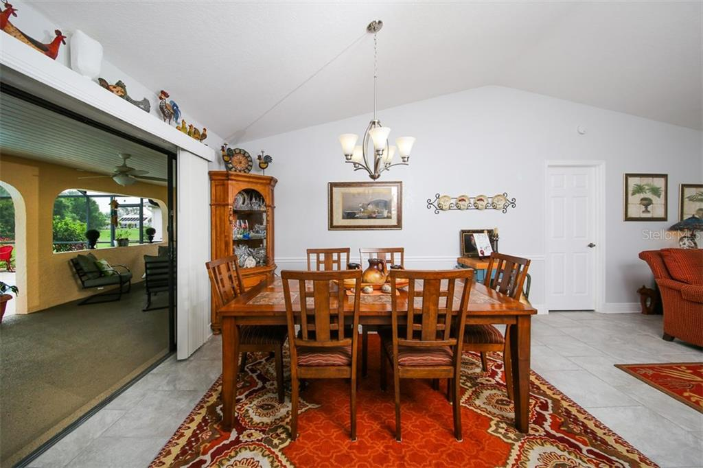 Dining room - Single Family Home for sale at 26178 Rampart Blvd, Punta Gorda, FL 33983 - MLS Number is C7240559