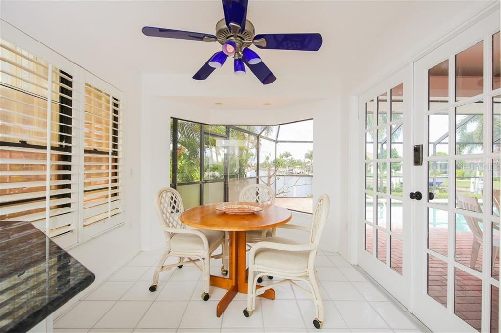 Kitchen nook with French doors to the stunning outdoors - Single Family Home for sale at 1620 Appian Dr, Punta Gorda, FL 33950 - MLS Number is C7242315