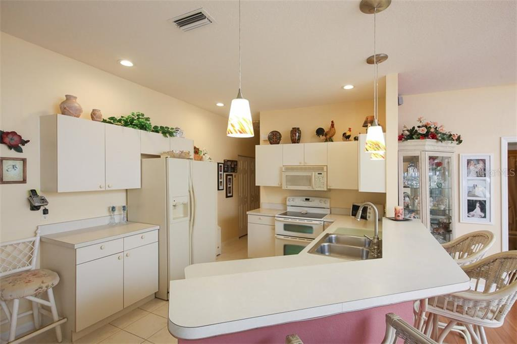 Light and bright kitchen with plenty of cabinets - Villa for sale at 1234 Green Oak Trl, Port Charlotte, FL 33948 - MLS Number is C7243720