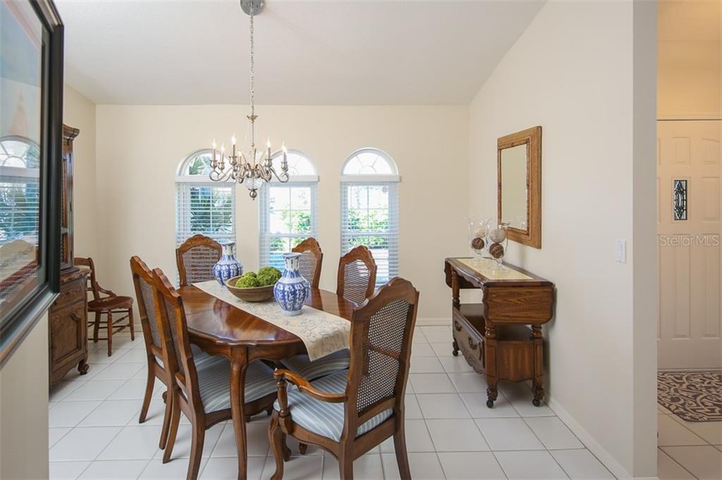 Spacious dining room with tile flooring - Single Family Home for sale at 4407 Albacore Cir, Port Charlotte, FL 33948 - MLS Number is C7245070
