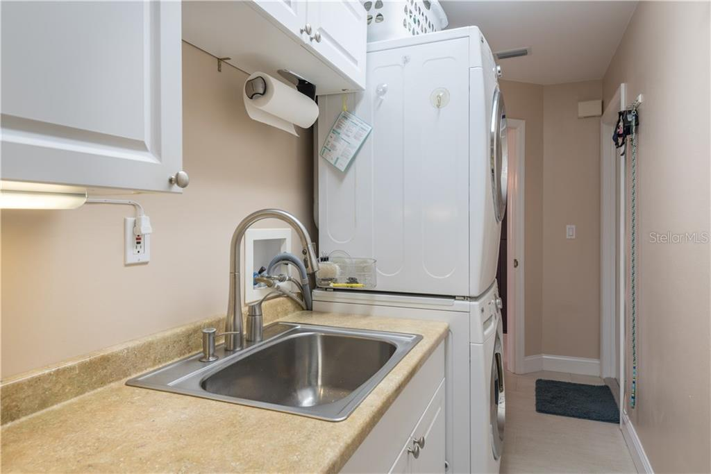 Indoor laundry room with full size, stacked washer & dryer. - Single Family Home for sale at 2510 Rio Largo Ct, Punta Gorda, FL 33950 - MLS Number is C7246934