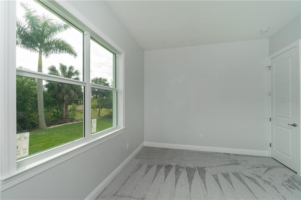 16' X 11' Bedroom 2 with walk in closet - Single Family Home for sale at 3302 Palm Dr, Punta Gorda, FL 33950 - MLS Number is C7247251