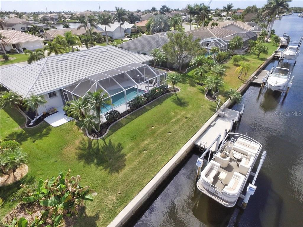 Great back yard, and easy access to the dock and boat lift. - Single Family Home for sale at 2526 Parisian Ct, Punta Gorda, FL 33950 - MLS Number is C7249726