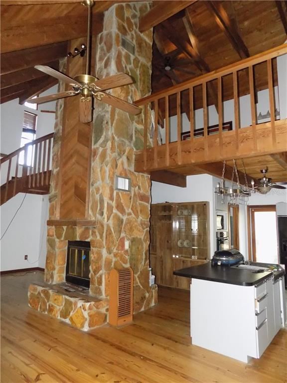 Main house living room looking up to loft bedroom - Single Family Home for sale at 5624 Reisterstown Rd, North Port, FL 34291 - MLS Number is C7250923
