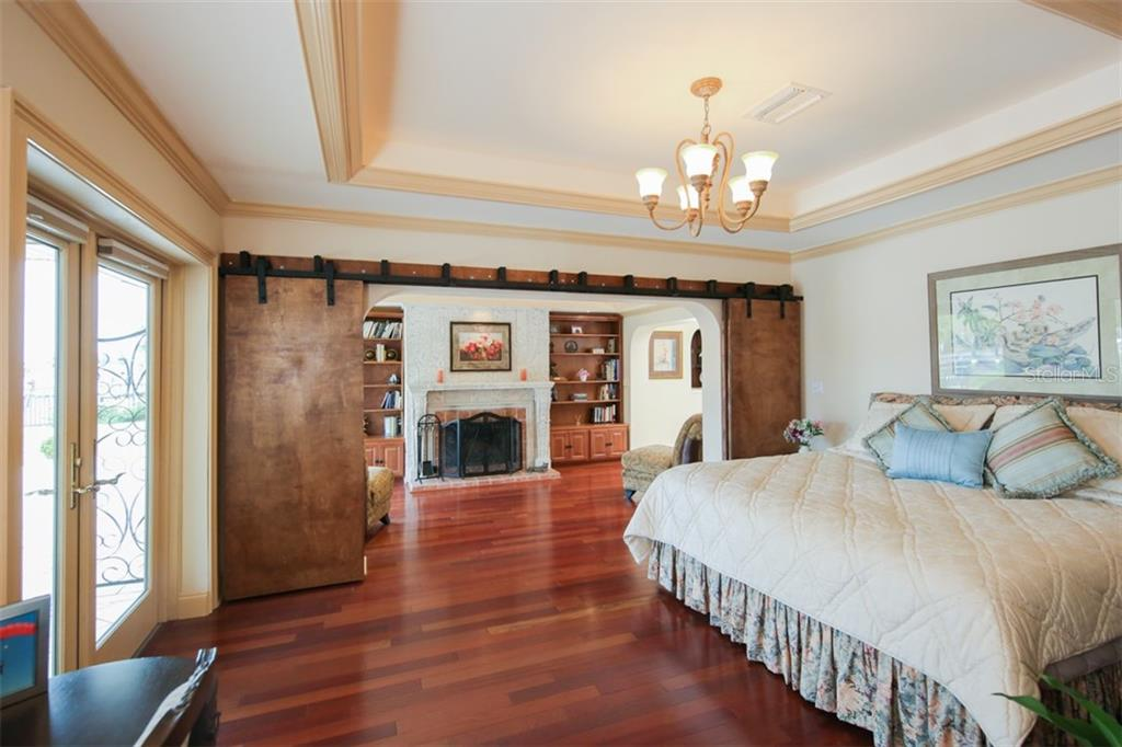 Master bedroom has a tray ceiling with crowing molding - comfortable sitting room with woodburning fireplace - Single Family Home for sale at 158 Morgan Ln Se, Port Charlotte, FL 33952 - MLS Number is C7400633