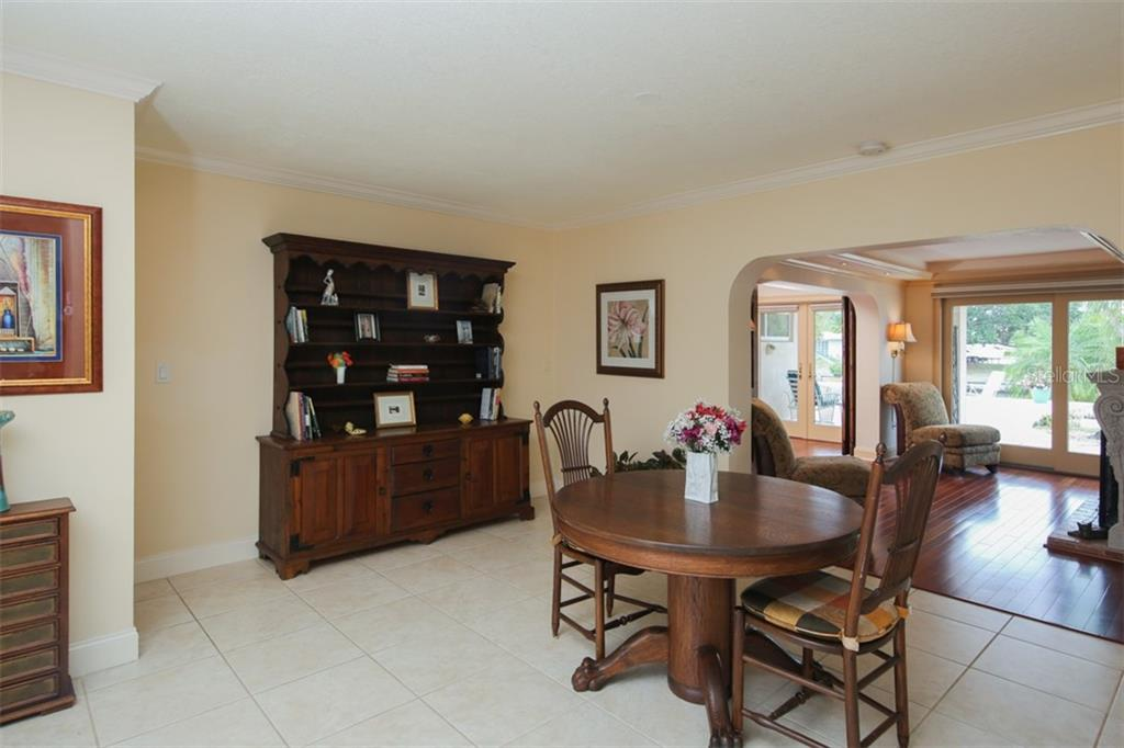 Dining area overlooks sitting room with views to the outdoors - Single Family Home for sale at 158 Morgan Ln Se, Port Charlotte, FL 33952 - MLS Number is C7400633