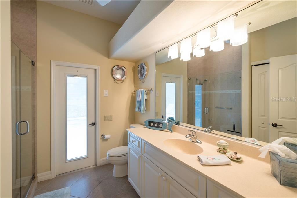 Guest bath with pool access. - Single Family Home for sale at 931 Linkside Way, Punta Gorda, FL 33955 - MLS Number is C7400849